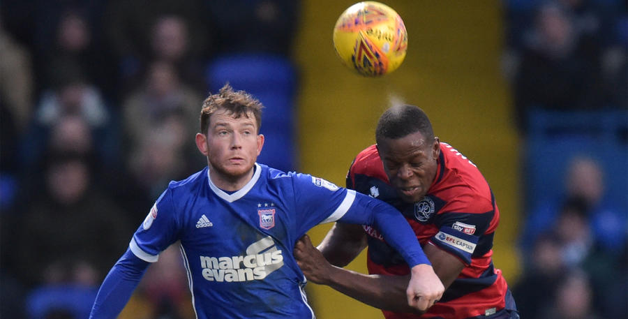 Nedum Onuoha wins a header against Joe Garner