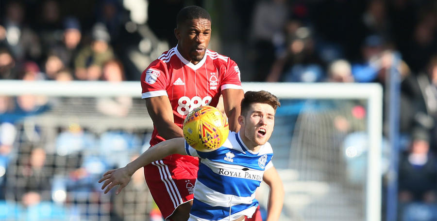Tendayi Darikwa challenges striker Paul Smyth for the ball